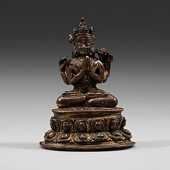6. A Tibetan copper alloy figure of Bodhisattva Shadakshari Lokeshvara, with traces of gilding, 16th century.