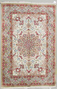 An oriental silk rug, possibly Qum, around 141 x 100 cm.
