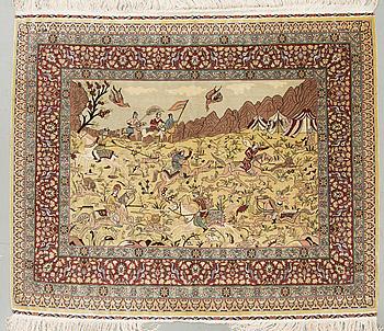 A silk rug, possibly Hereke, around 98 x 123 cm.