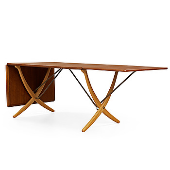 A Hans J Wegner teak and beech dinner table by Andreas Tuck, Denmark 1950-60's.