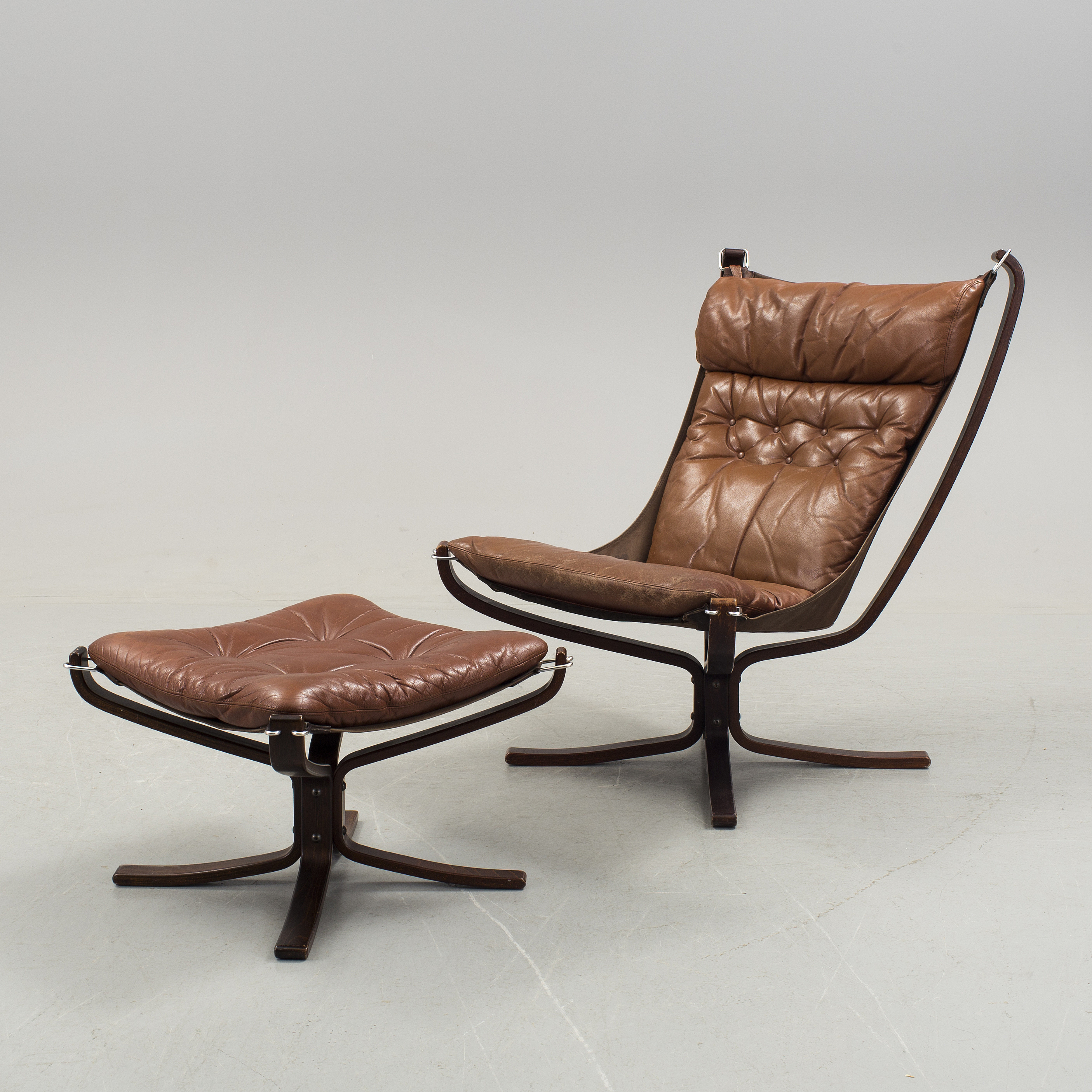 An armchair with footstool  Falcon chair  Sigurd Russel Vatne möbler Norway 1970s. - Bukowskis & An armchair with footstool