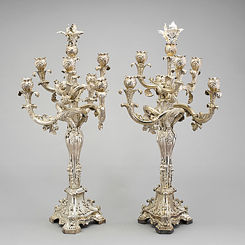 A pair of Neo-Rococo silver candelabra by Gustaf Möllenborg, Stockholm, 1845. Total weight ca 5920 grams.