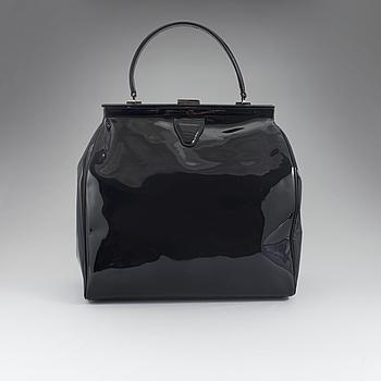A lacquer bag by Rochas Paris.