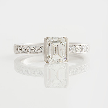 A 1.03 cts emerald-cut and 0.19 cts brilliant-cut diamond ring.