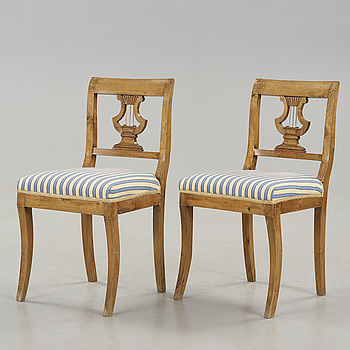 EMPIRE, A pair of birchwood Karl Johan chairs first half of the 19th century.