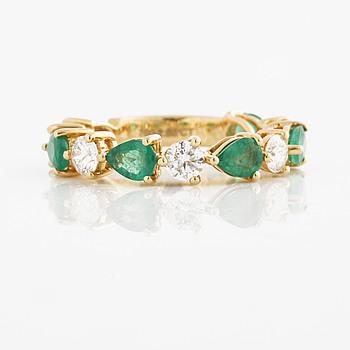 A ca 1.50 cts emerald and ca 1.00 cts brilliant-cut diamond ring.