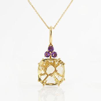 A yellow quartz and amethyst pendant.