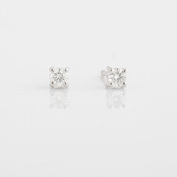 A pair of ca 0.20 cts brilliant-cut diamond earrings.