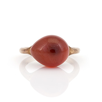 POMELLATO, A 'Rouge Passion' ring by Pomellato set with a cabochon-cut, synthetic, orange sapphire.