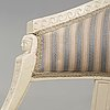 A pair of late gustavian armchairs in the manner of ephraim ståhl, master in stockholm 1794-1820.