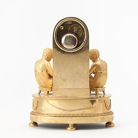 A french empire early 19th century gilt bronze mantel clock.