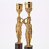 A pair of late gustavian early 19th century porphyry and ormolu candlesticks.