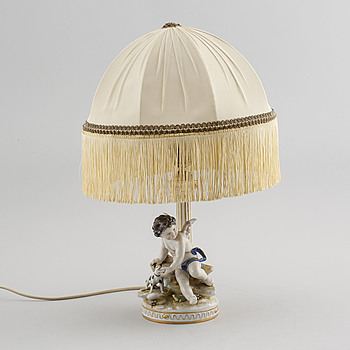 A porcelain table lamp, made in the first half of the 20th century.