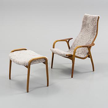 """YNGVE EKSTRÖM, A """"Lamino"""" lounge chair and stool by Yngve Ekström."""