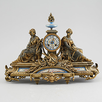 A Louis XVI style table clock, around the year 1900.