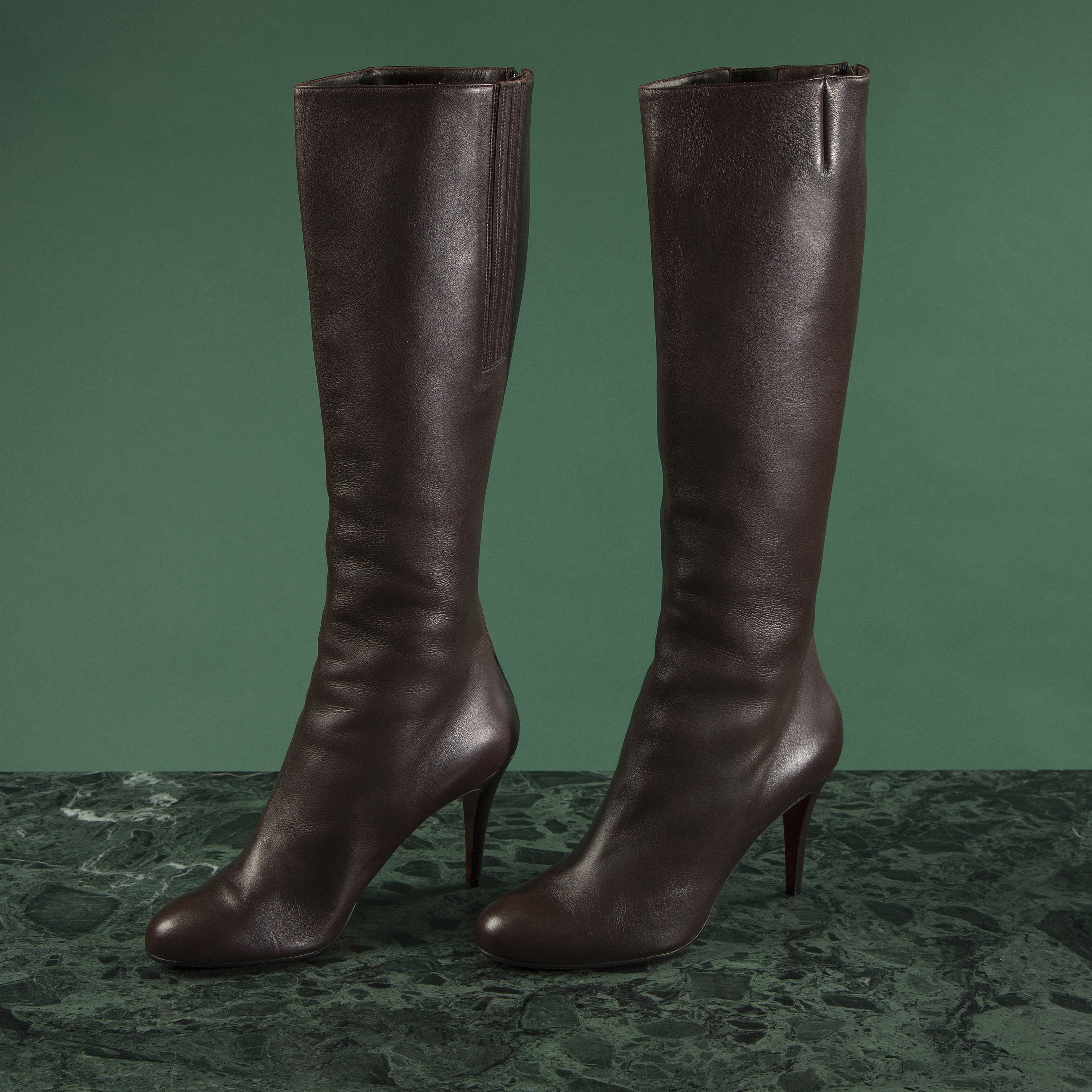 e8244078117 A pair of brown leather boots by Christian Louboutin, size 41 1/2 ...