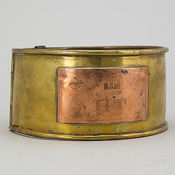 A 19th century brass dog collar.