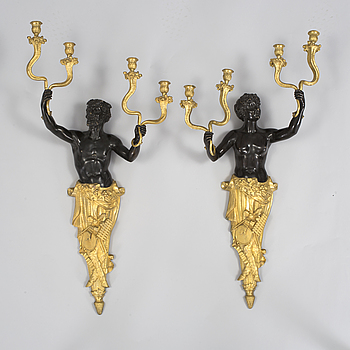 A pair of Louis Philippe 1830/1840's gilt and patinated bronze four-light wall-lights.