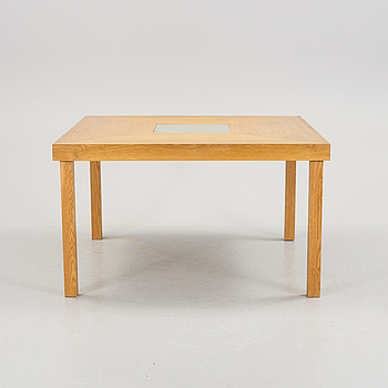 An oak table with partially slate top, about 2000.