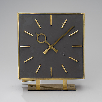 "A TWO SIDED WALL CLOCK. From ""Kuparitalo"" (Copper House) in Helsinki. Late 1950s."