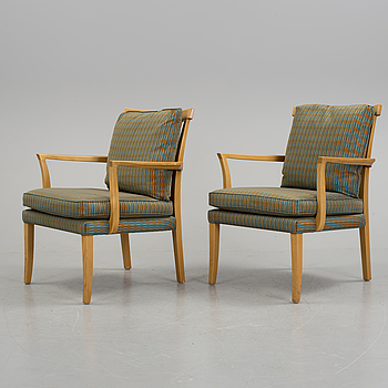 A pair of 'Aron' beech armchairs from Norell.