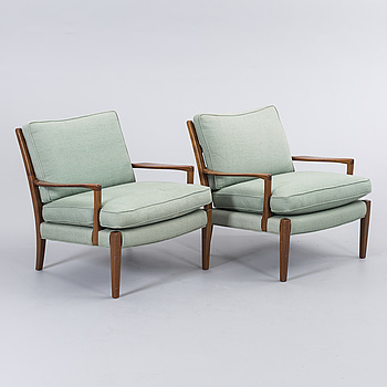 A COUPLE OF ARNE NORELL ARMCHAIRS.