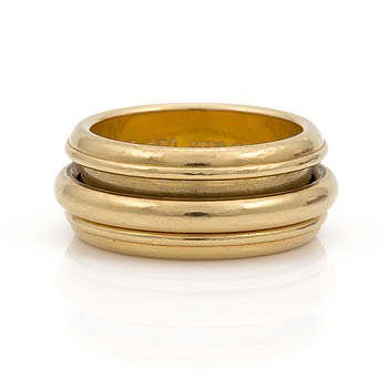 A ring signed Piaget, serial no; A09249. Engraved PIAGET 1990.