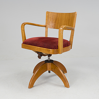 A desk chair from the first half of the 20th century.