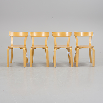 ALVAR AALTO, A set of four model 66 chairs by Alavar Aalto.