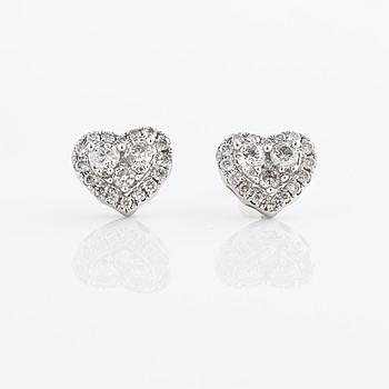 A pair of ca 0.80 cts brilliant cut diamond earrings.