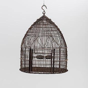 A BIRD CAGE.