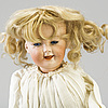 A mechanical bisque head doll by heubach, probably 7669, germany, c. 1912.