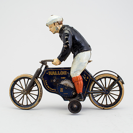 A partially hand painted tinplate lehmann halloh motorcycle, germany. in production 1914-41.