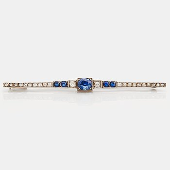 796. A brooch set with sapphires, old- and rose cut diamonds.