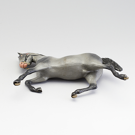 A painted tinplate toy horse ca year 1900.