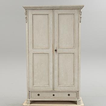 A wardrobe, circa 1900.
