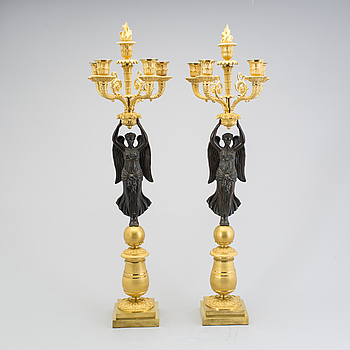 EMPIRE, A large pair of first half of the 19th century gilt and patinated bronze five-light candelabra.