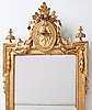 A gustavian mirror by per westin, dated 1778.