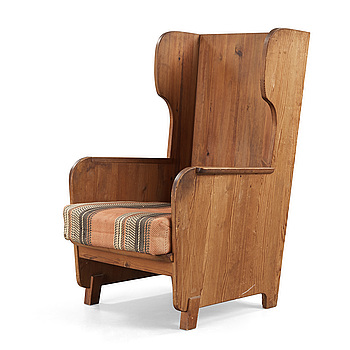 An Axel Einar Hjorth 'Lovö' stained pine armchair, Nordiska Kompaniet, Sweden 1930's.