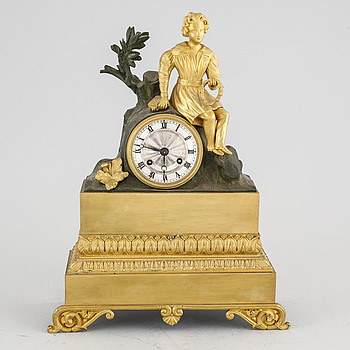 A late empire table clock, around the mid 19th century.