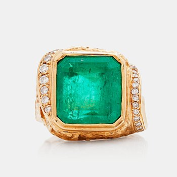 809. A circa 8.80 ct emerald and brilliant cut diamond ring. Total carat weight of diamonds circa 0.40 ct. Probably 1980's.