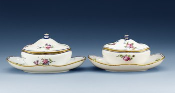 Two Sèvres sauce tureens on stands, 18th Century, one soft paste, dated HH for 1785. Length 23 cm.