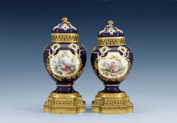 A pair of gilt bronze mounted Sevres pot-pourri jars with covers, 18th Century. (2). Blue Sèvres mark and painter´s mark 9, presumably for Mere...