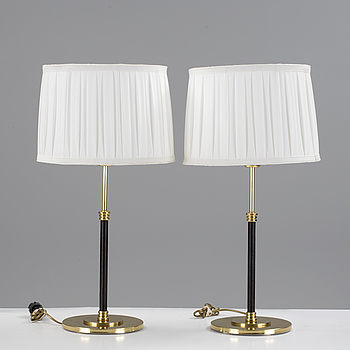 A pair of brass and leather table lights by Blond Belysning värnamo, 2000's.