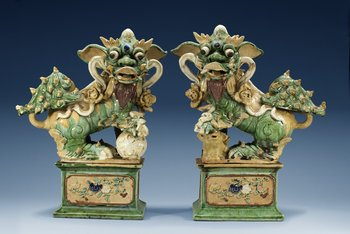 A pair of figures of Buddhist Lions on stands, Qing dynasty (1644-1912). (2). Height 53 cm.