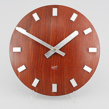 A wall clock from LM Ericsson, from the second half of the 20th century.