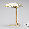 Paavo tynell, a desk lamp. shell. manufactured by taito oy. designed in 1938/39.