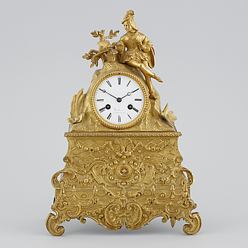 A table clock from Rolland, Versailles, second half of the 20th century.
