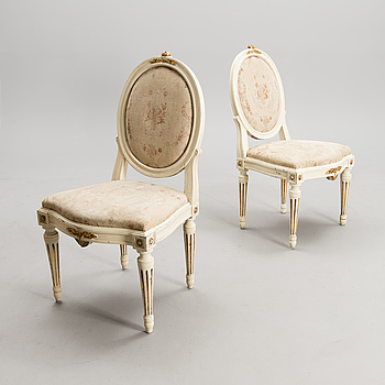 A pair of early 19th century chairs.