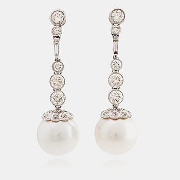 789. A pair of cultured south sea pearl and brilliant cut diamond earrings. Total carat weight of diamonds circa 3.30 cts.
